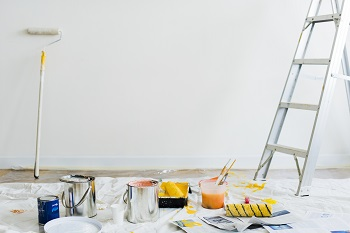 Buckets of paint on the floor, moving guide